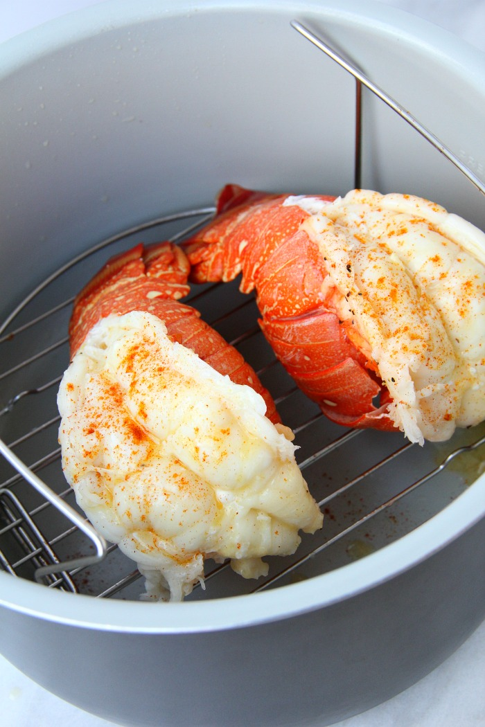 lobster tails on rack in Ninja Foodi