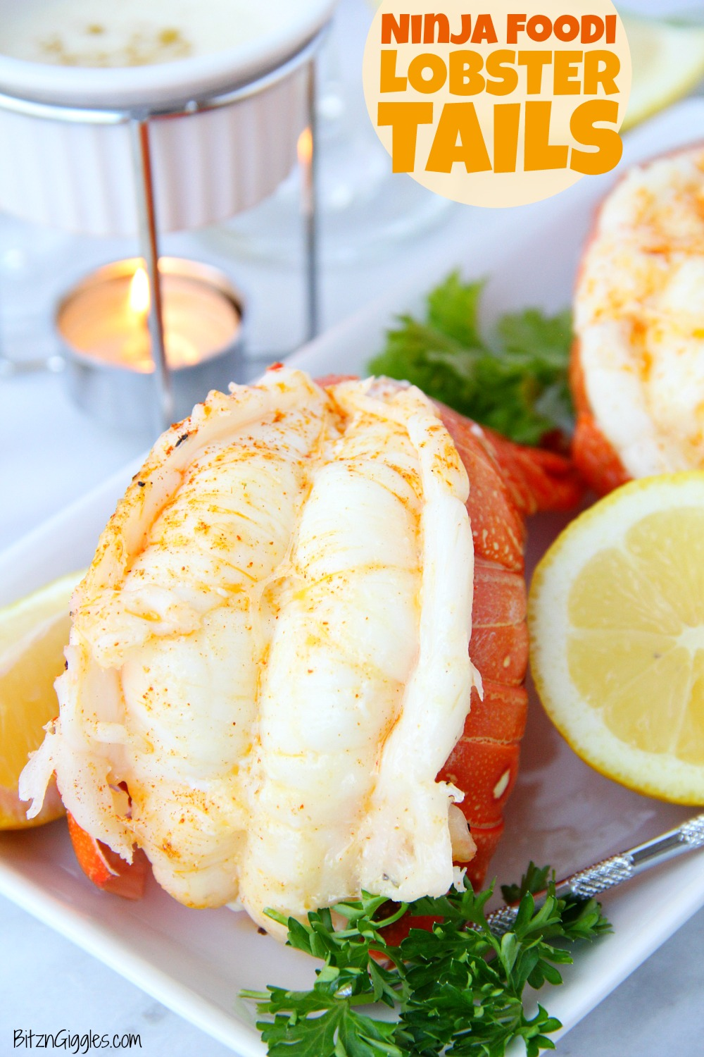 Lobster tails on table with melted butter and wine glass