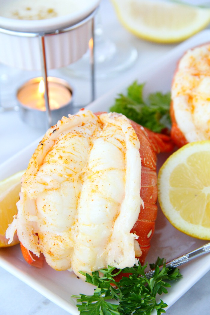 close up of lobster tail with lemon