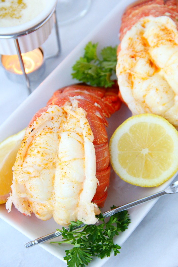 lobster tails with lemon on plate