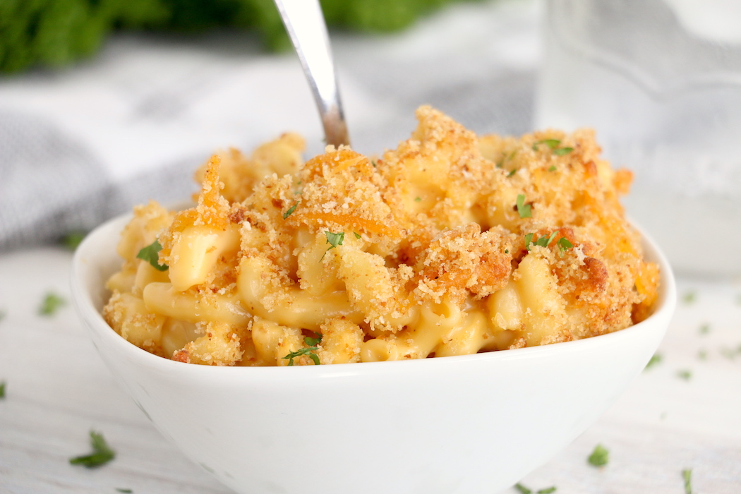 bowl of macaroni and cheese with spoon