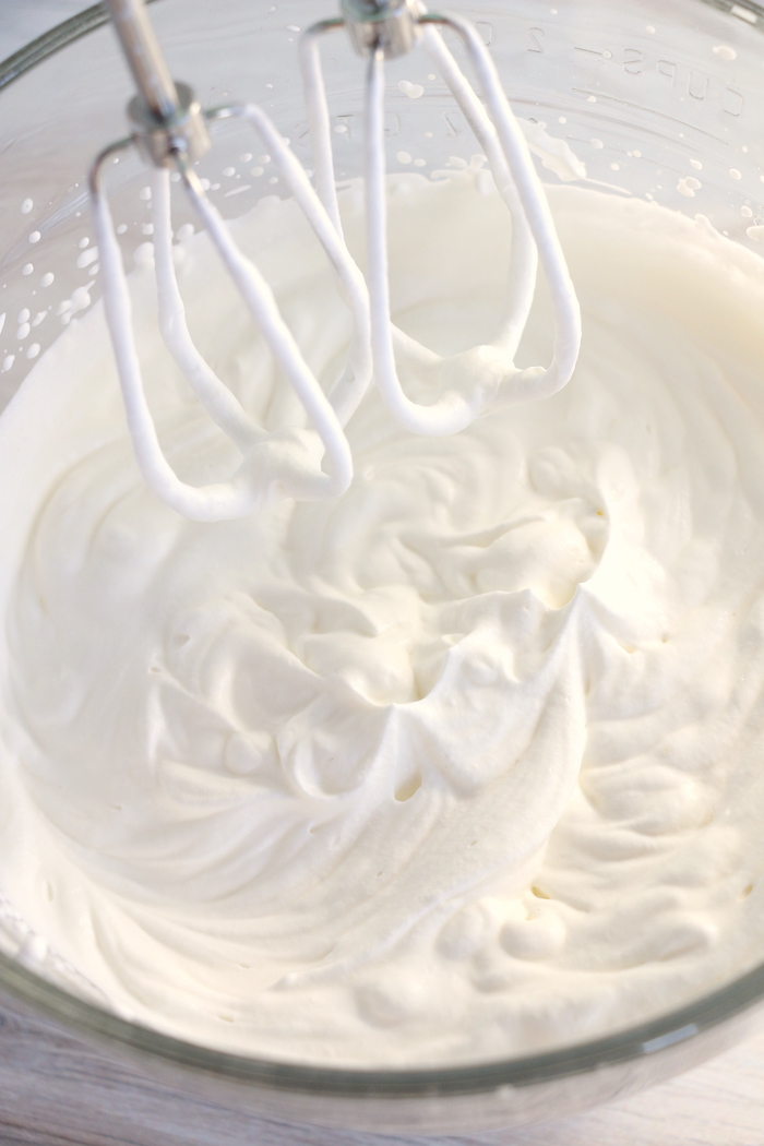 whipping heavy whipping cream with hand mixer