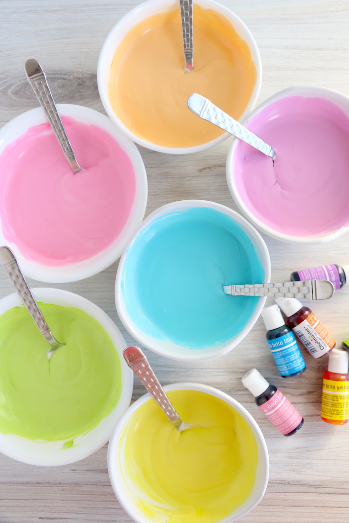 six bowls filled with colored ice cream