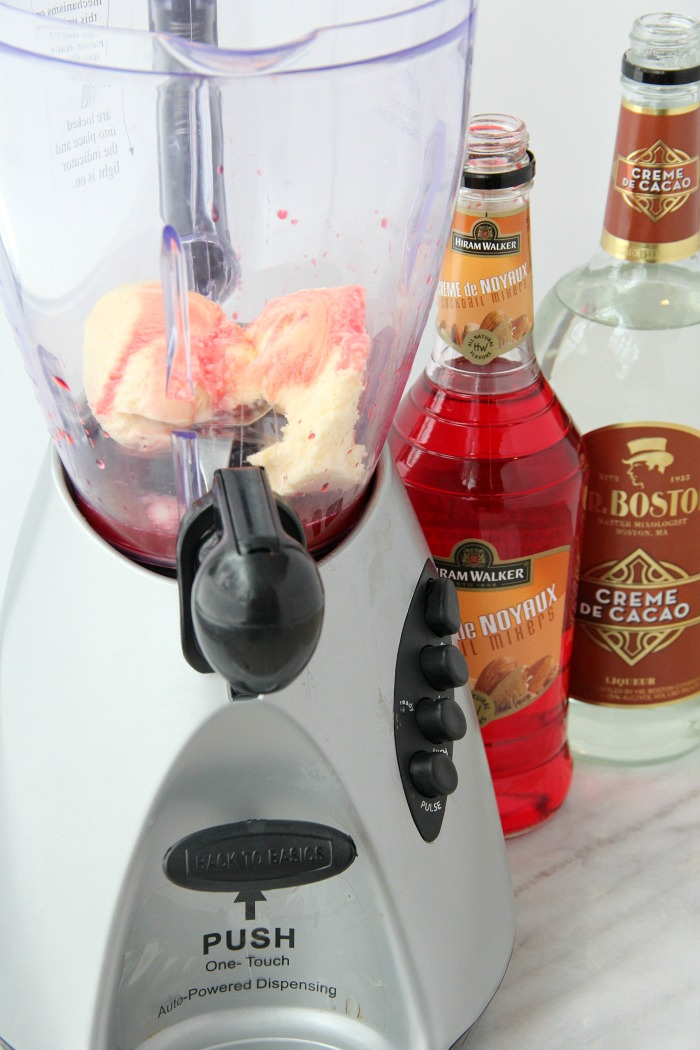blender filled with ice cream and almond and chocolate liqueur