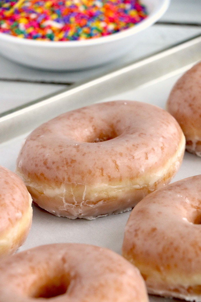 tray of glazed donuts