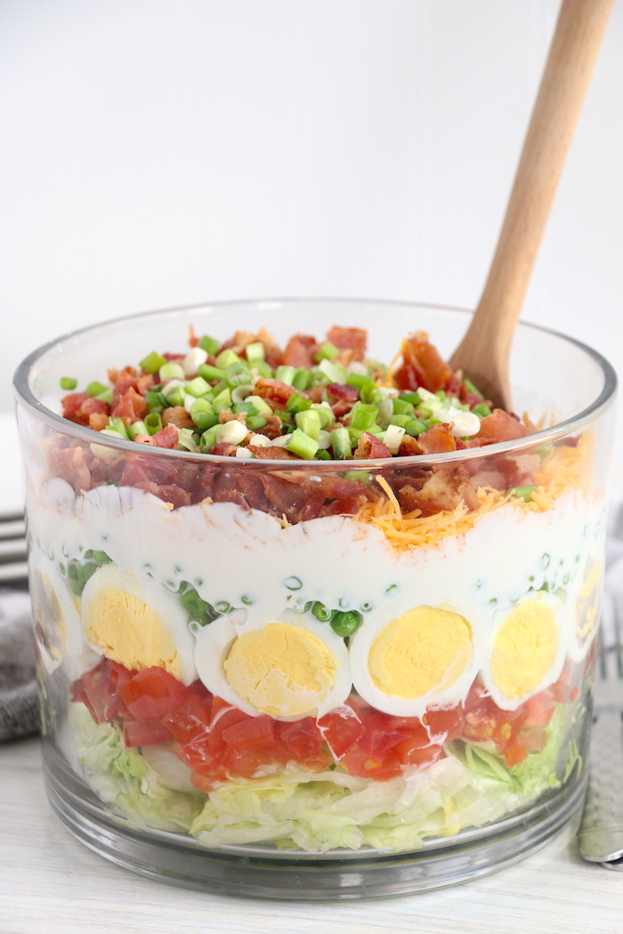 seven layer salad with spoon