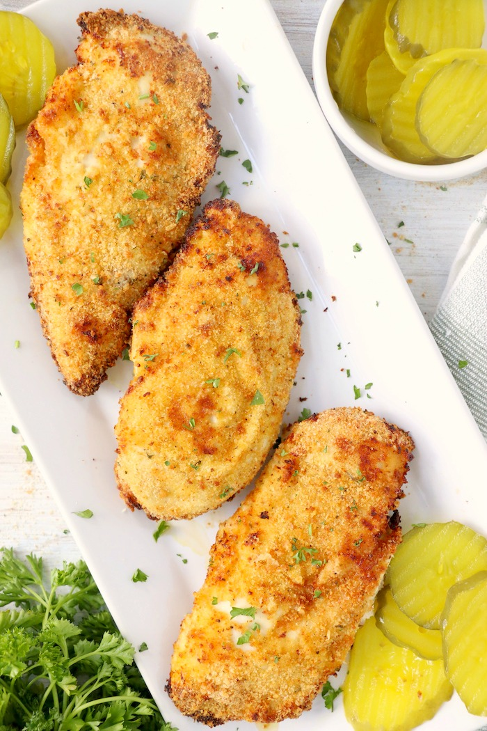 Crispy, breaded chicken breasts on platter