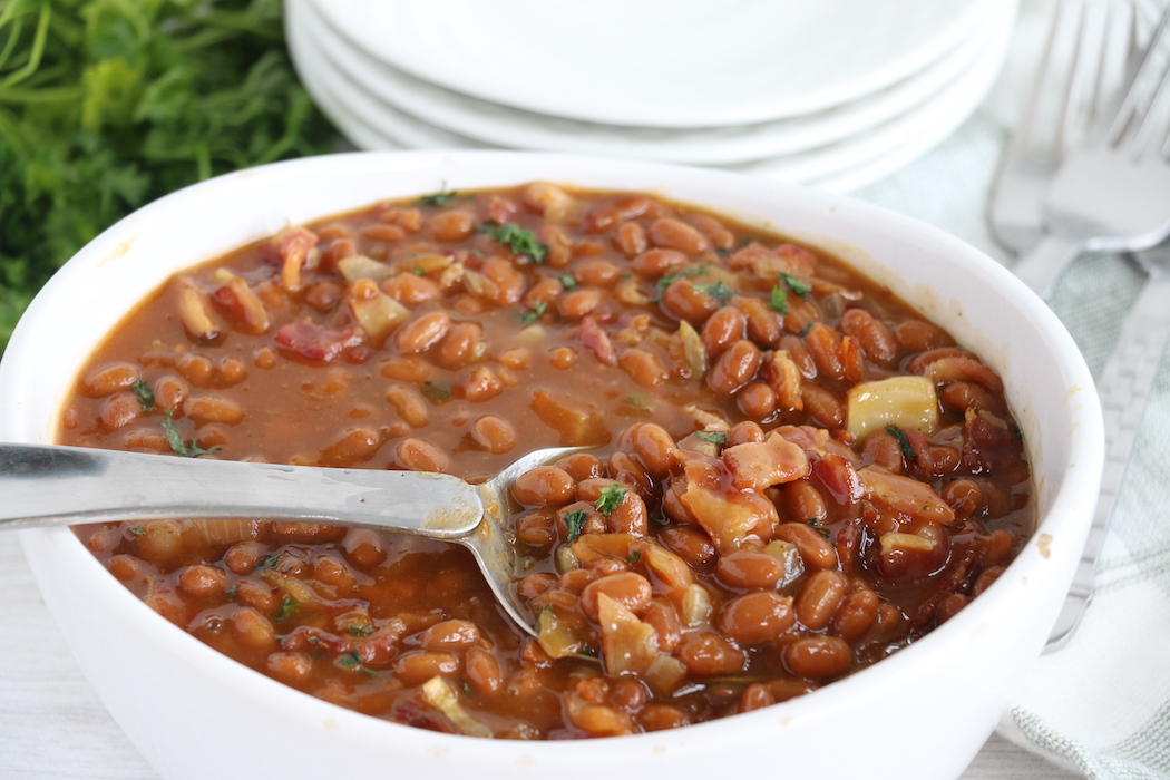 spoon in dish of baked beans