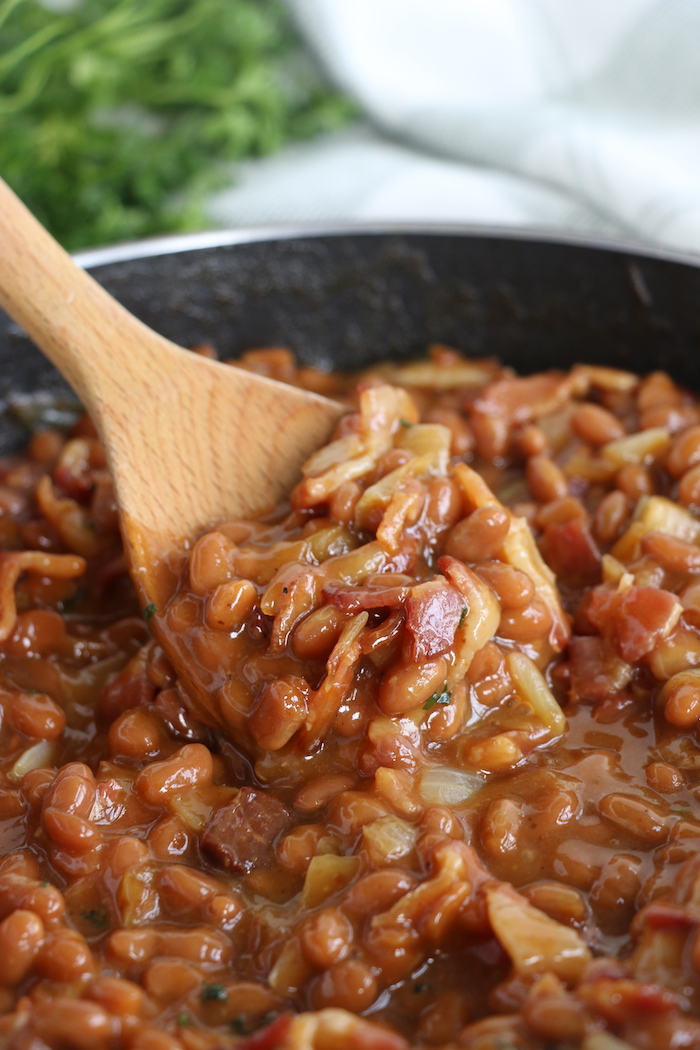 Wooden spoonful of baked beans