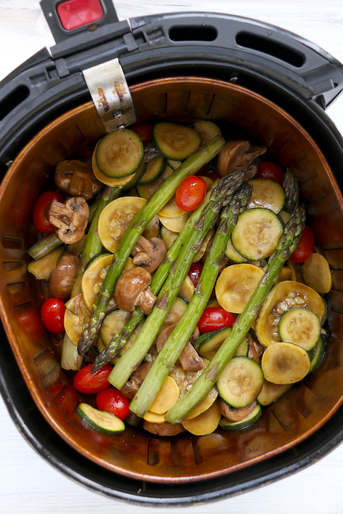 air fryer basket filled with vegetables
