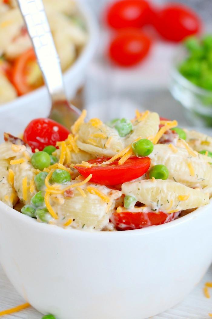 Small white bowl of bacon ranch pasta salad