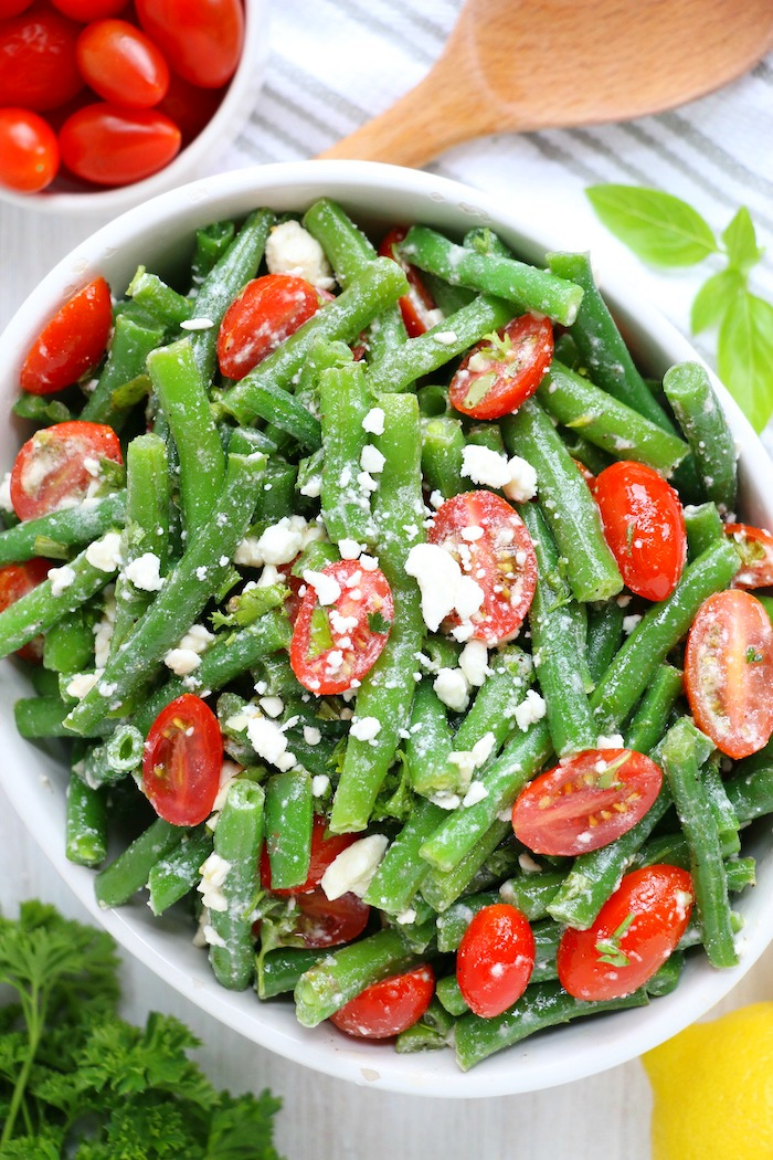 Green bean salad in bowl with feta cheese