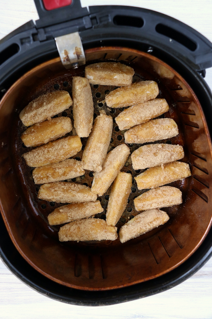 Apple slices in an air fryer basket