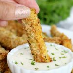 dipping a zucchini fry in ranch