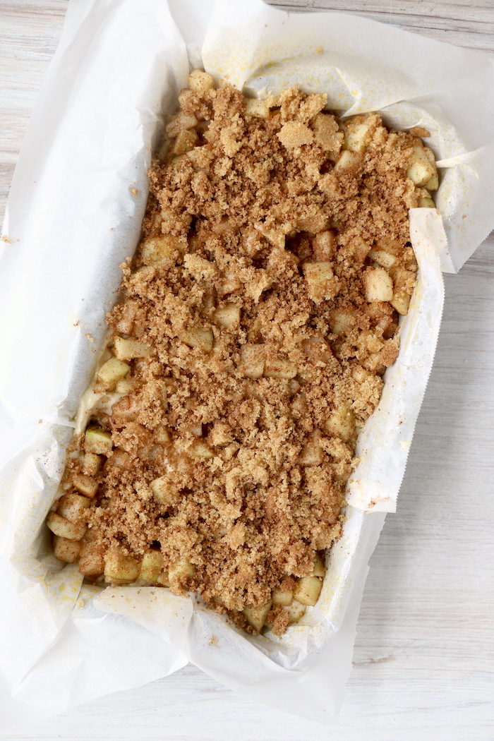 Cinnamon sugar mixture on top of fresh apple bread