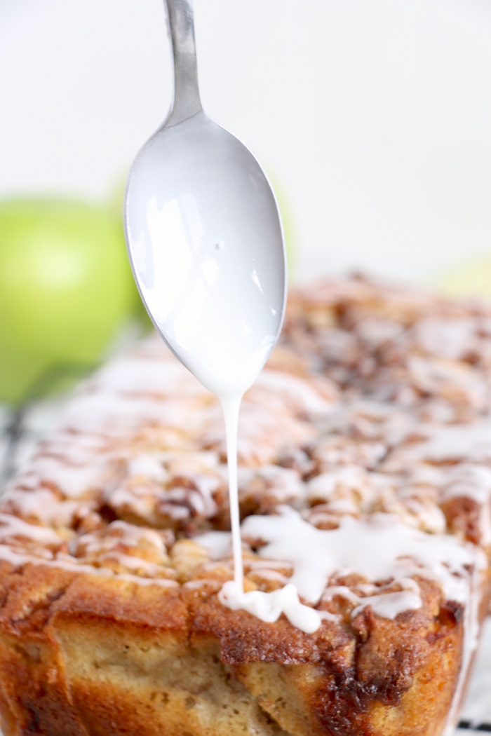 using a spoon to drizzle icing with a spoon