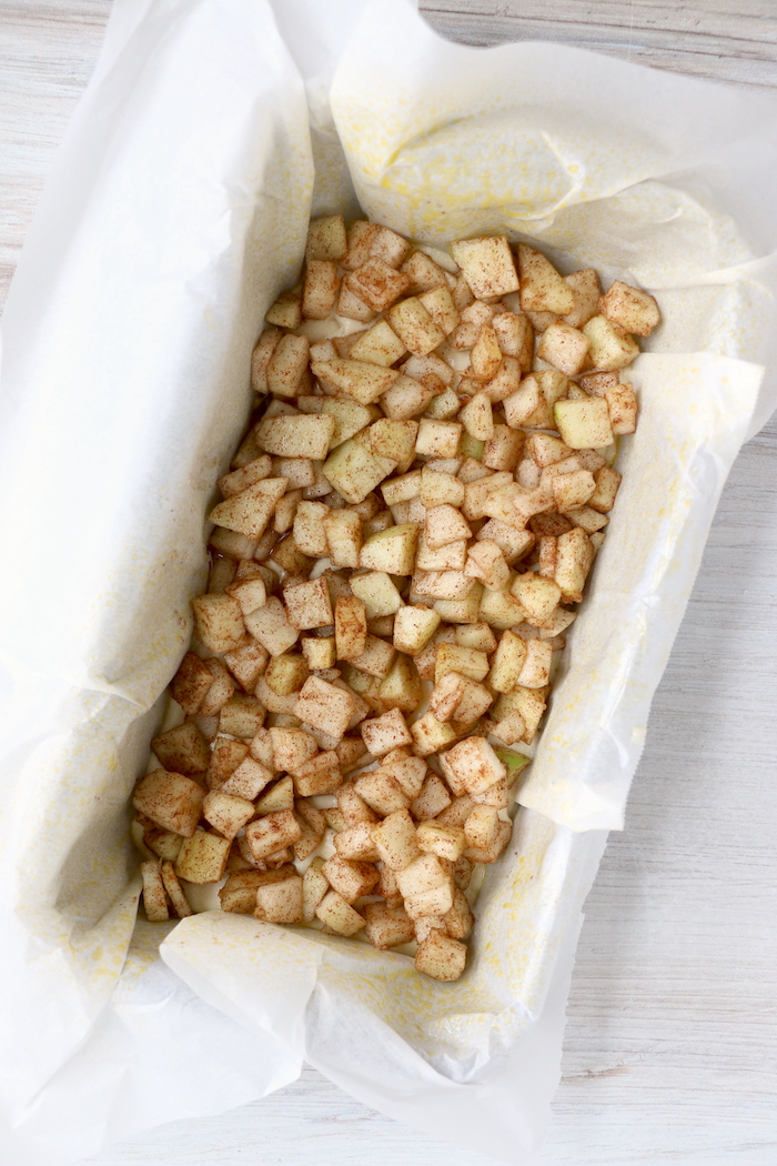 chopped apples in bread pan