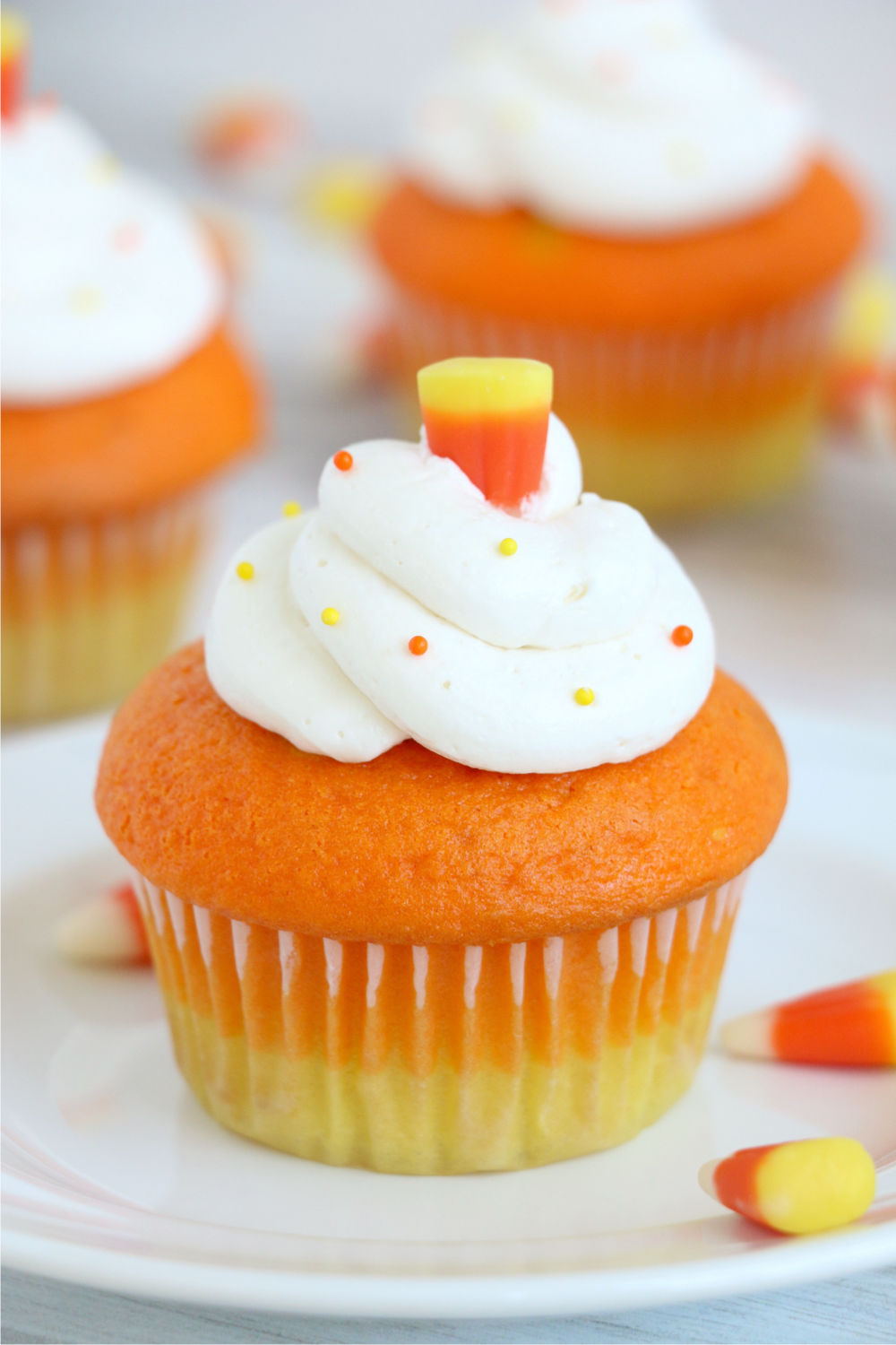Candy corn cupcakes with candy corn on top