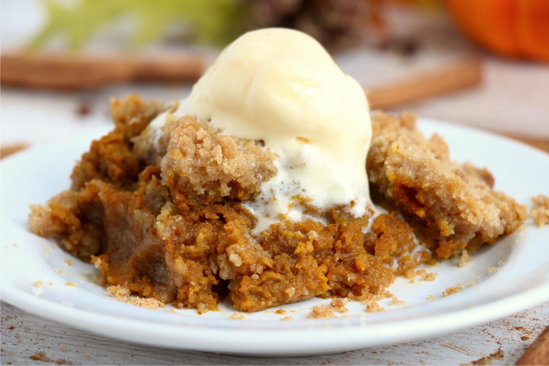 piece of pumpkin crisp on plate with scoop of ice cream