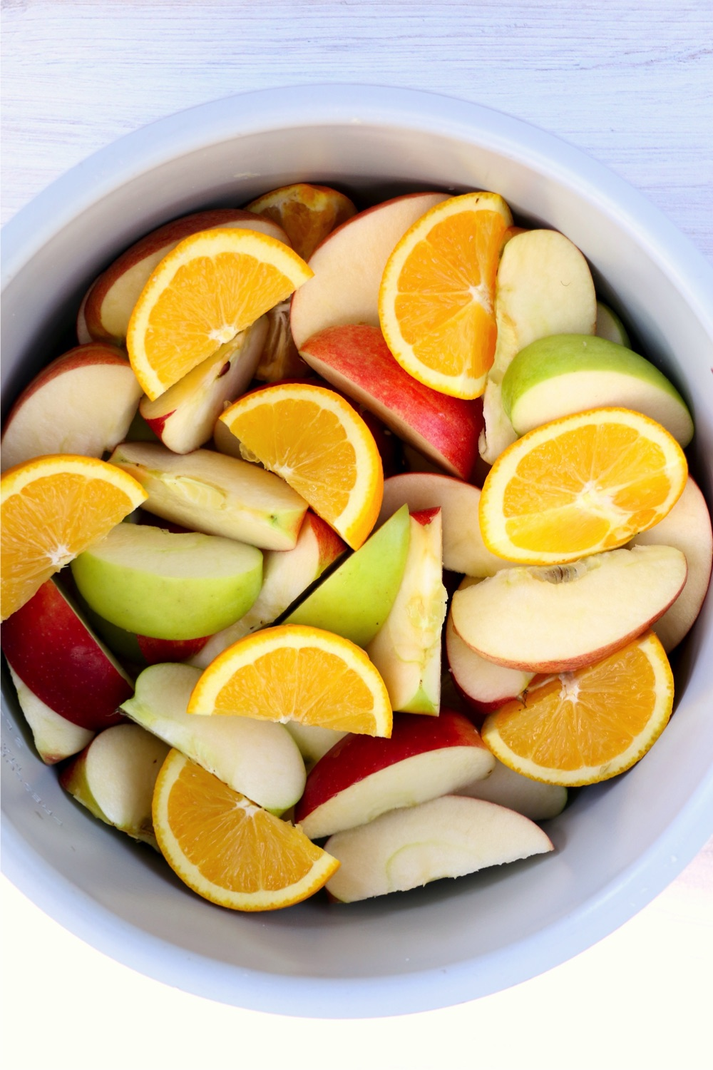 Ninja Foodi pot filled with sliced apples and oranges