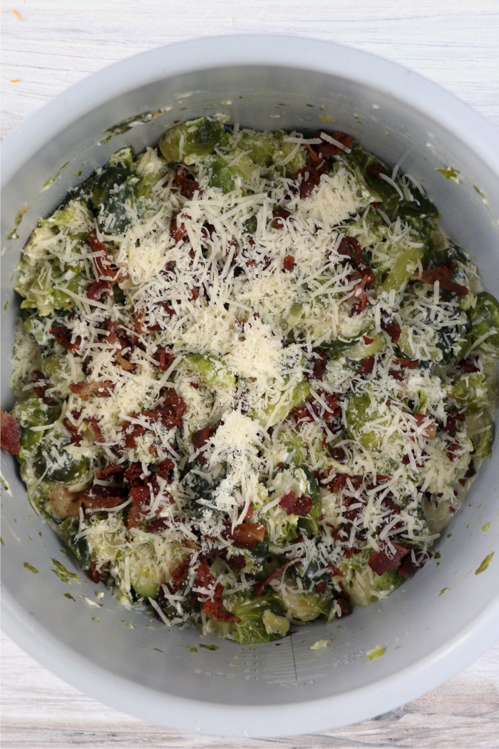 parmesan cheese and bacon on top of Brussels Sprouts