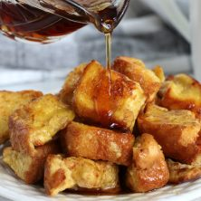 pouring syrup on pieces of french toast