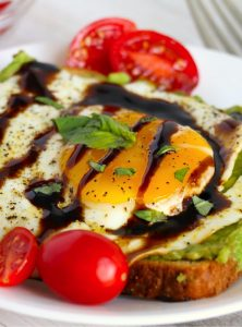 Egg on avocado toast with cherry tomatoes