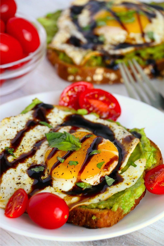 Egg with basil and balsamic glaze on avocado toast