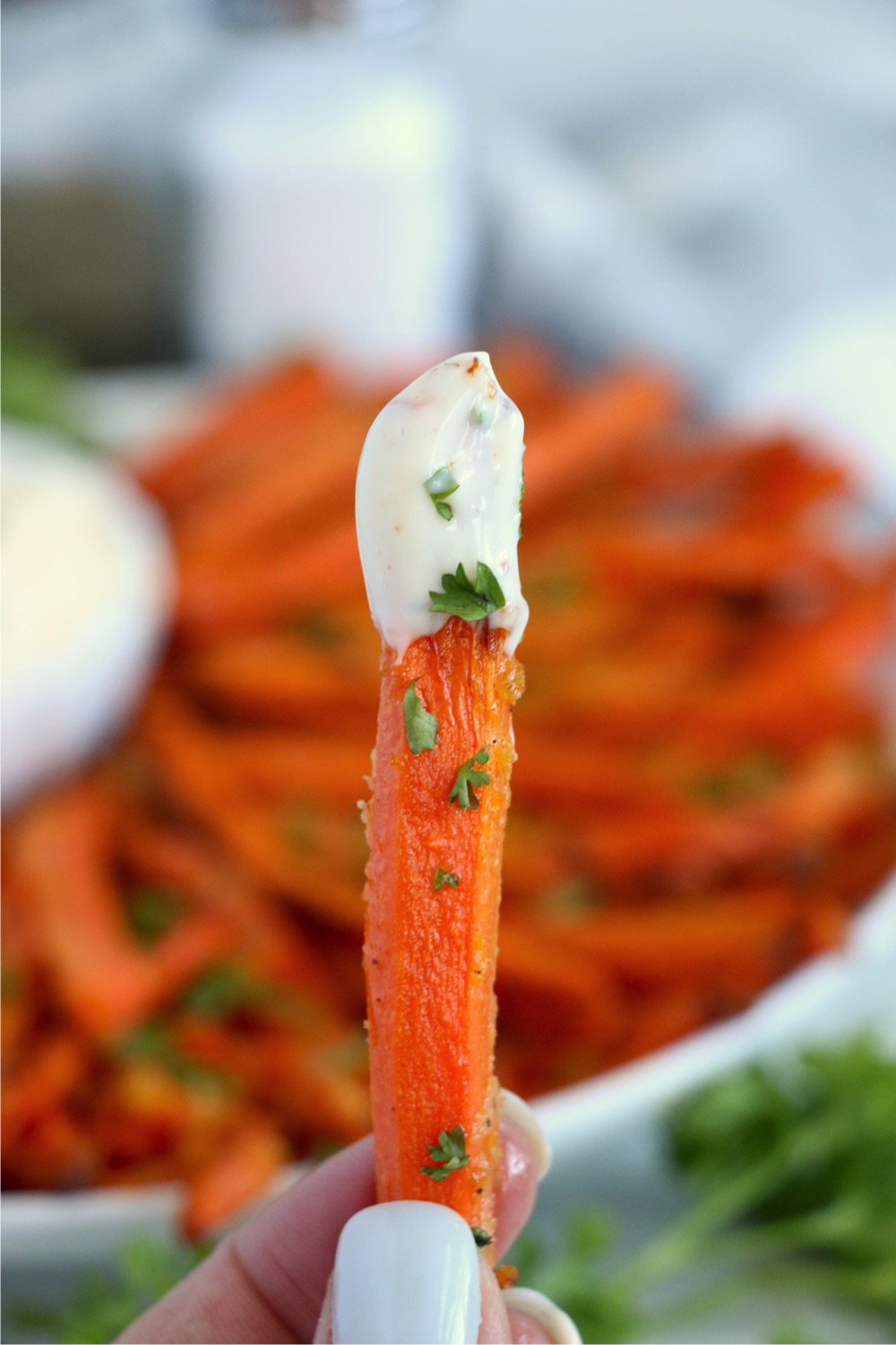 single carrot fry with dipping sauce on end