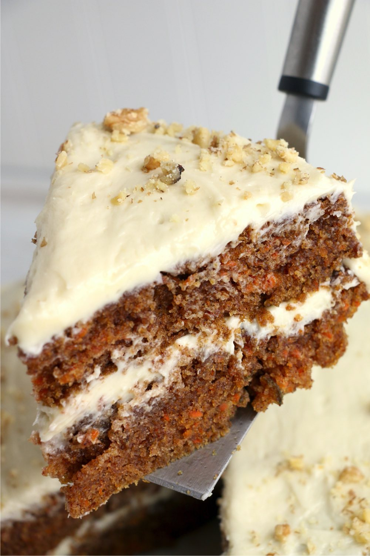 cake server holding piece of carrot cake
