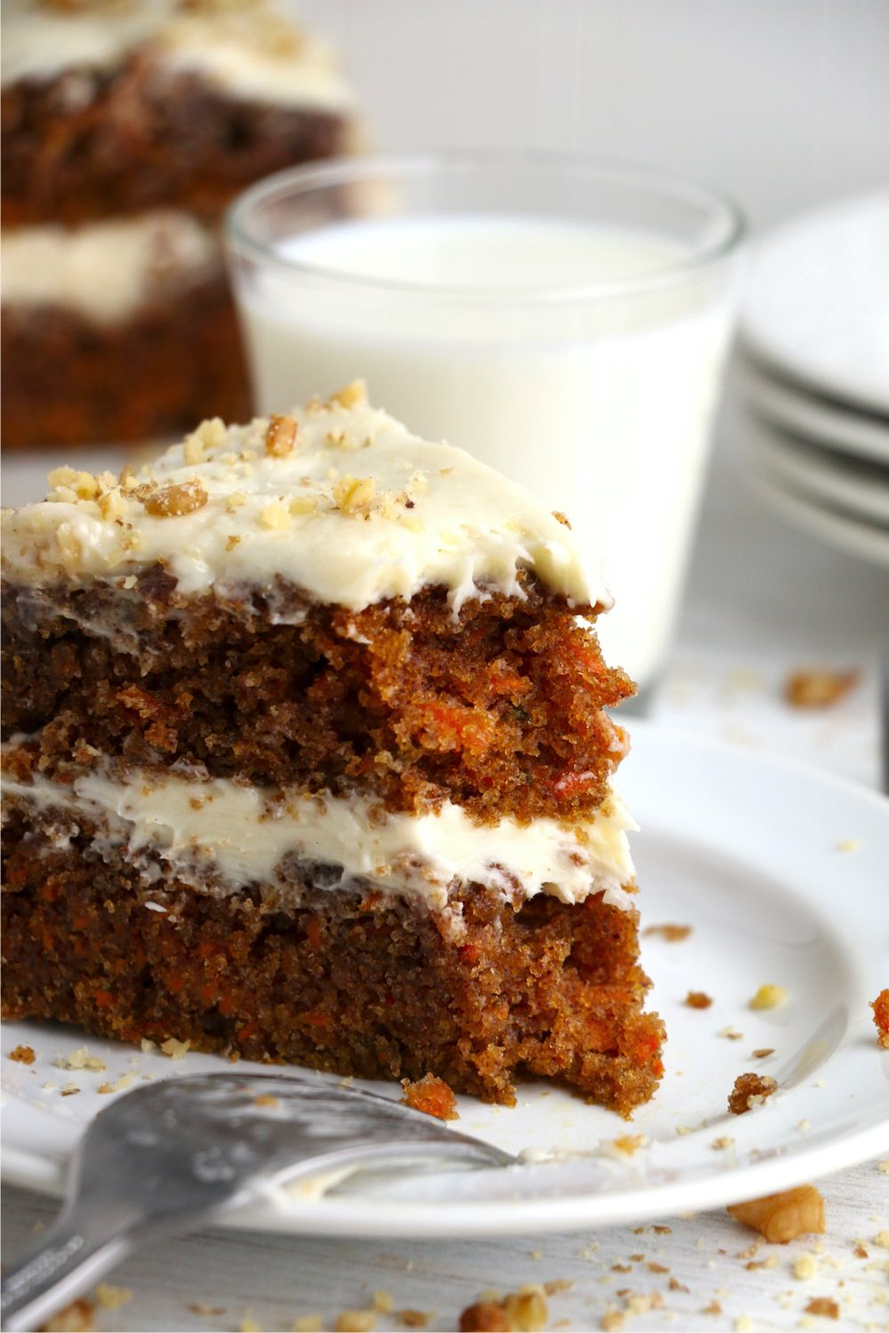 Piece of carrot cake being eaten with fork
