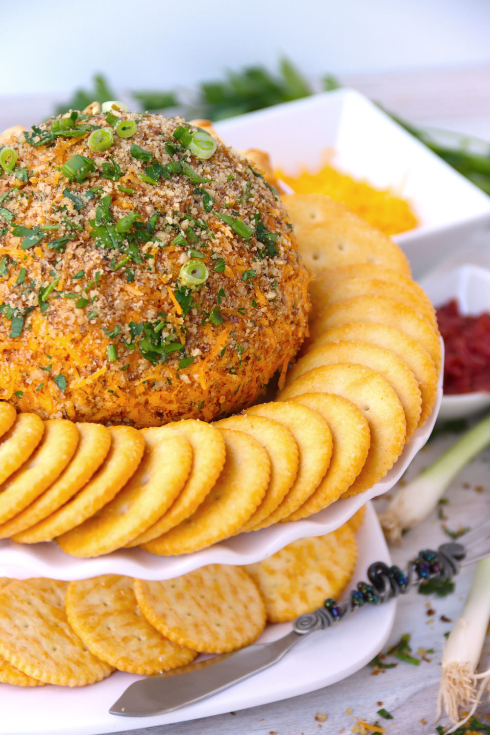 close up of cheese ball with crackers