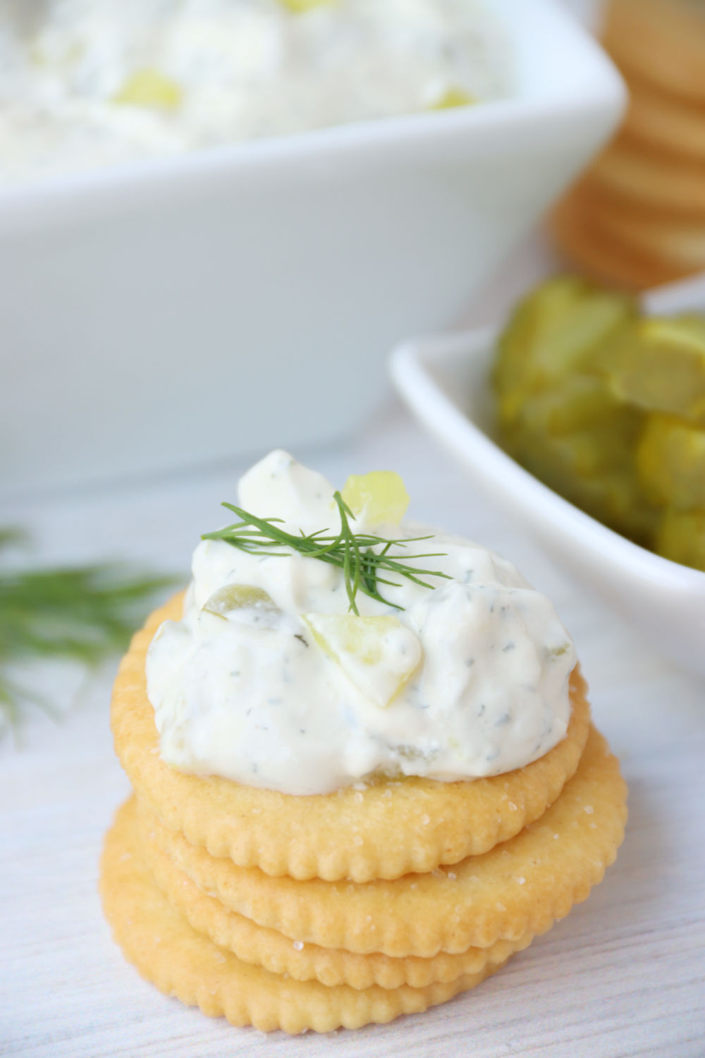 dill pickle dip on a stack of crackers