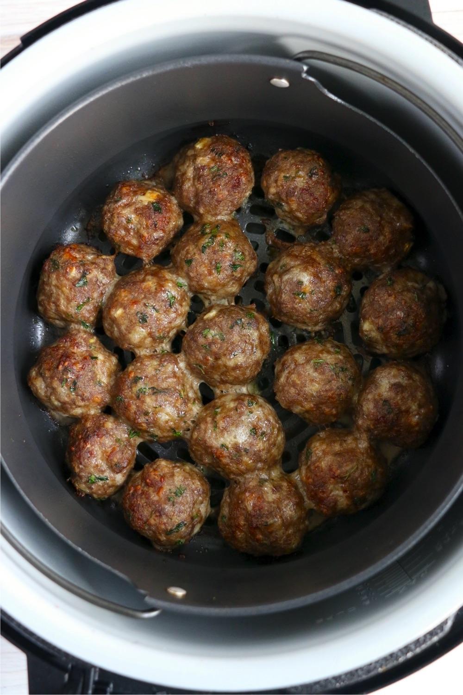 cooked meatballs in Ninja Foodi air crisp basket