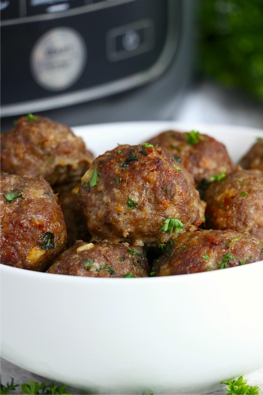 bowl of meatballs in front of Ninja Foodi