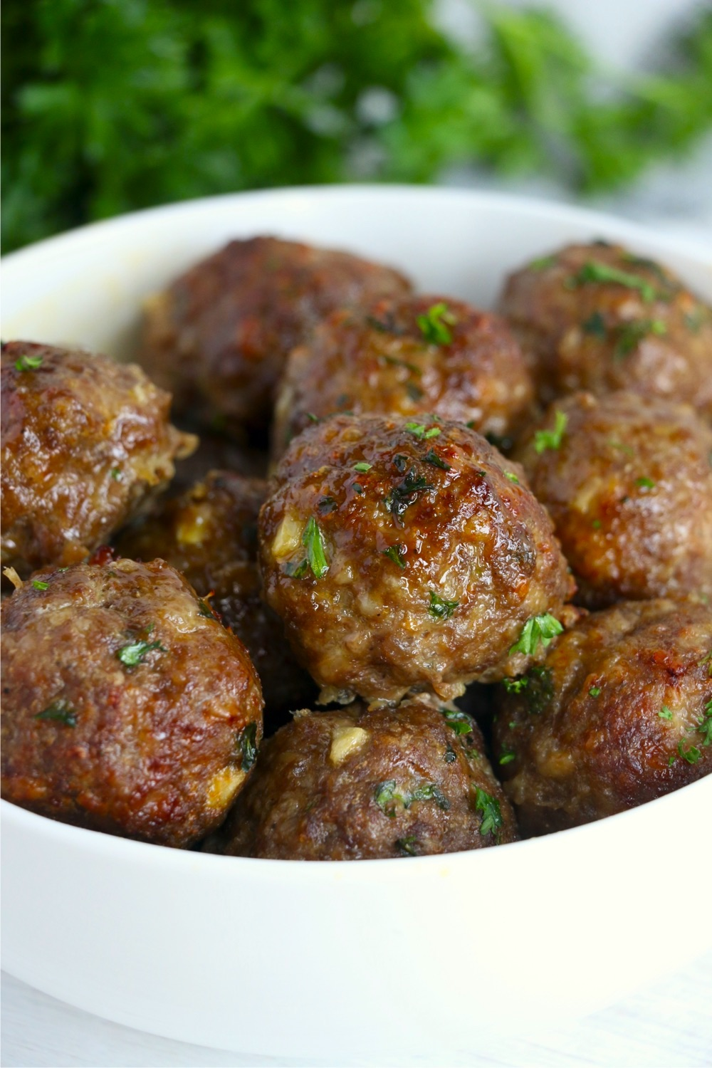 bowl of meatballs garnished with parsley