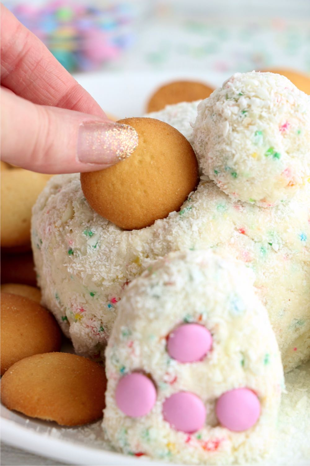dipping a vanilla wafer in an Easter cheese ball