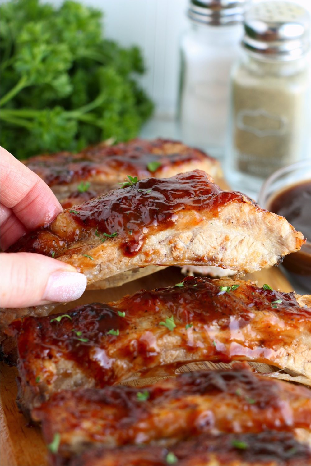 holding piece of BBQ ribs