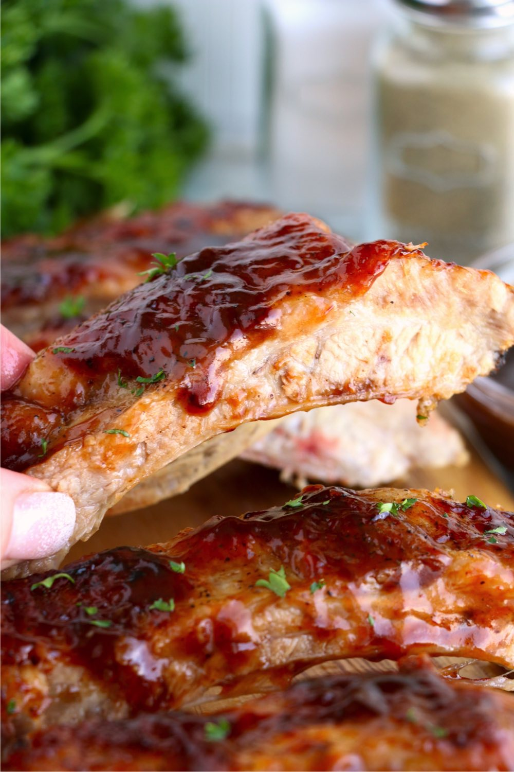 piece of BBQ ribs with sauce on them