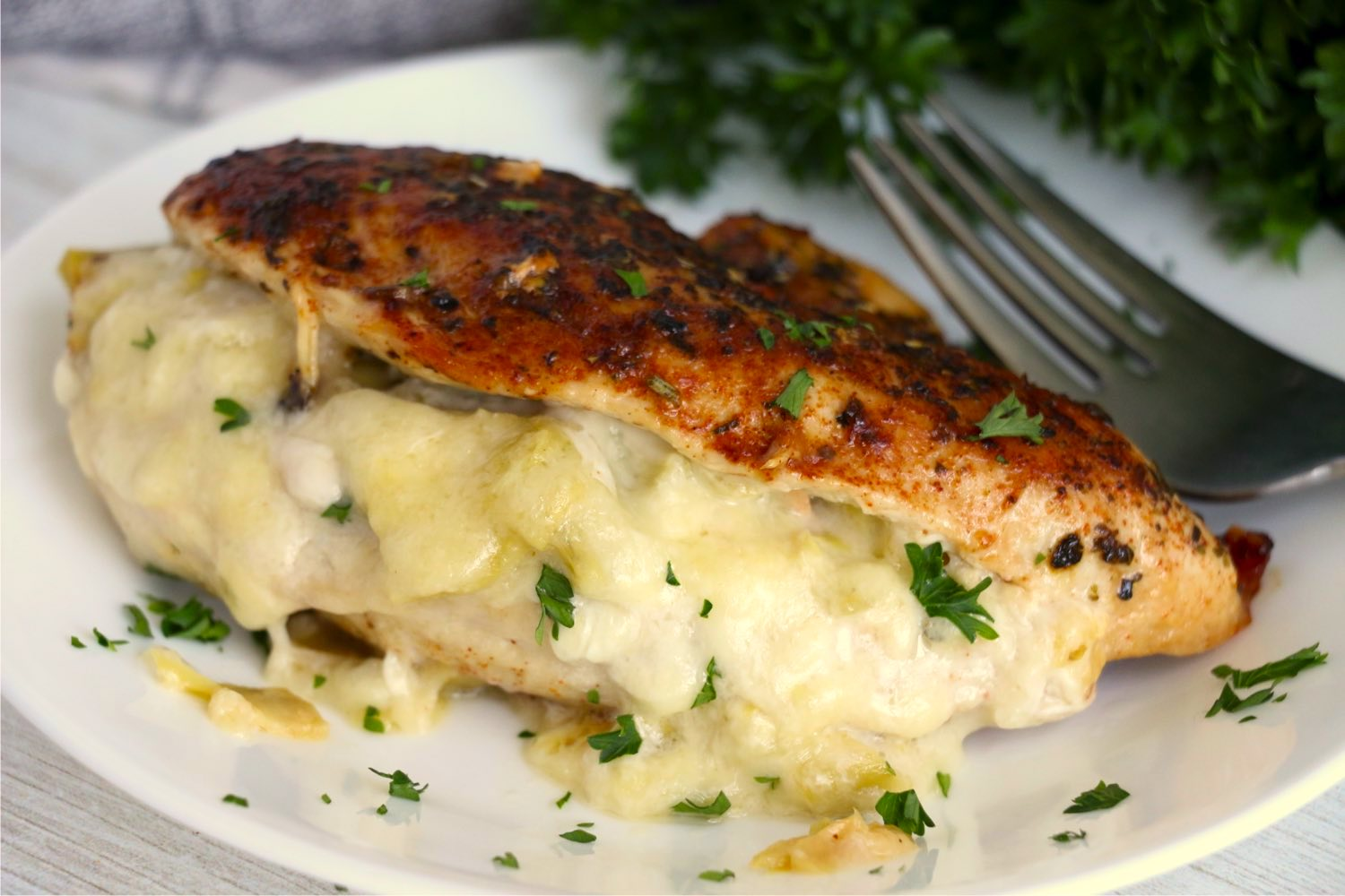 Chicken breast stuffed with a cheesy artichoke filling