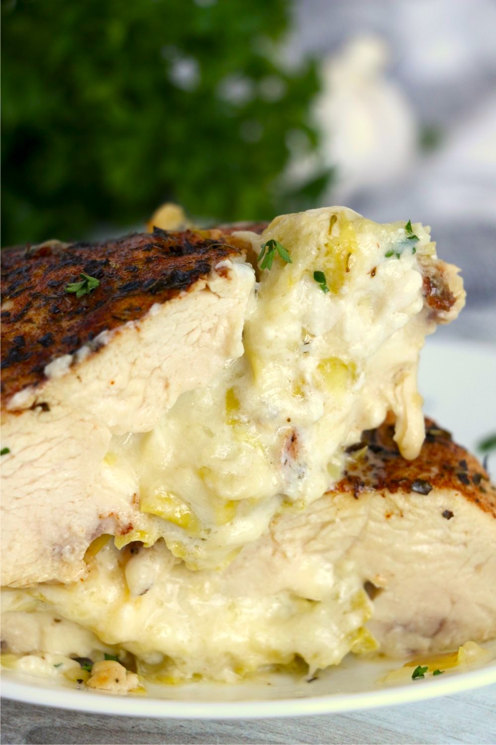 stacked chicken breast halves with artichoke filling