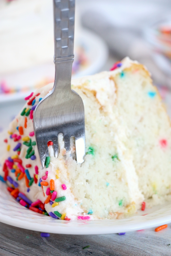 fork going into piece of confetti cake