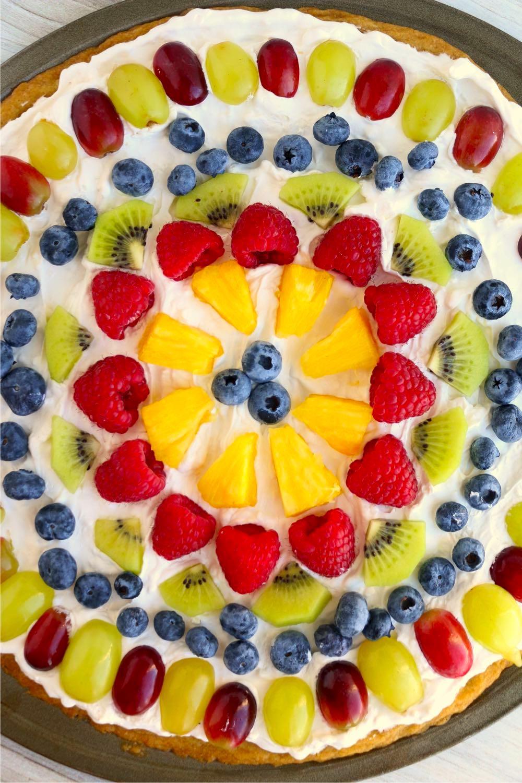 Fresh fruit neatly arranged on a fruit pizza