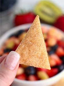 holding up a pie crust chip
