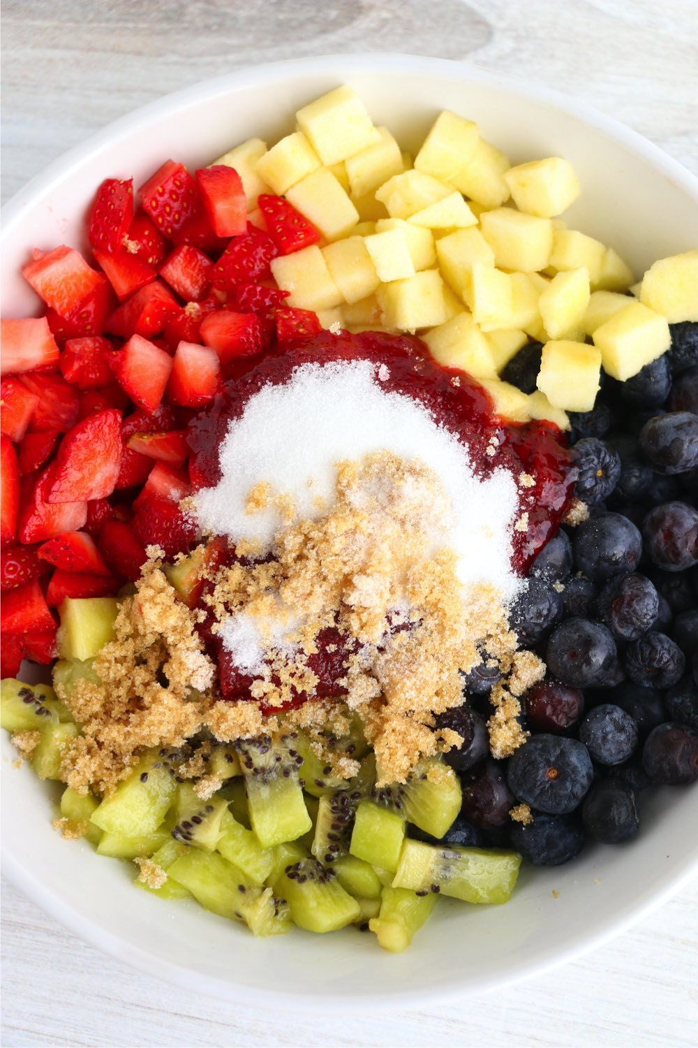 fruit in bowl with sugar and jam
