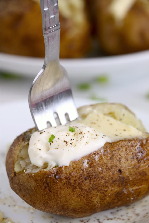 fork going into baked potato