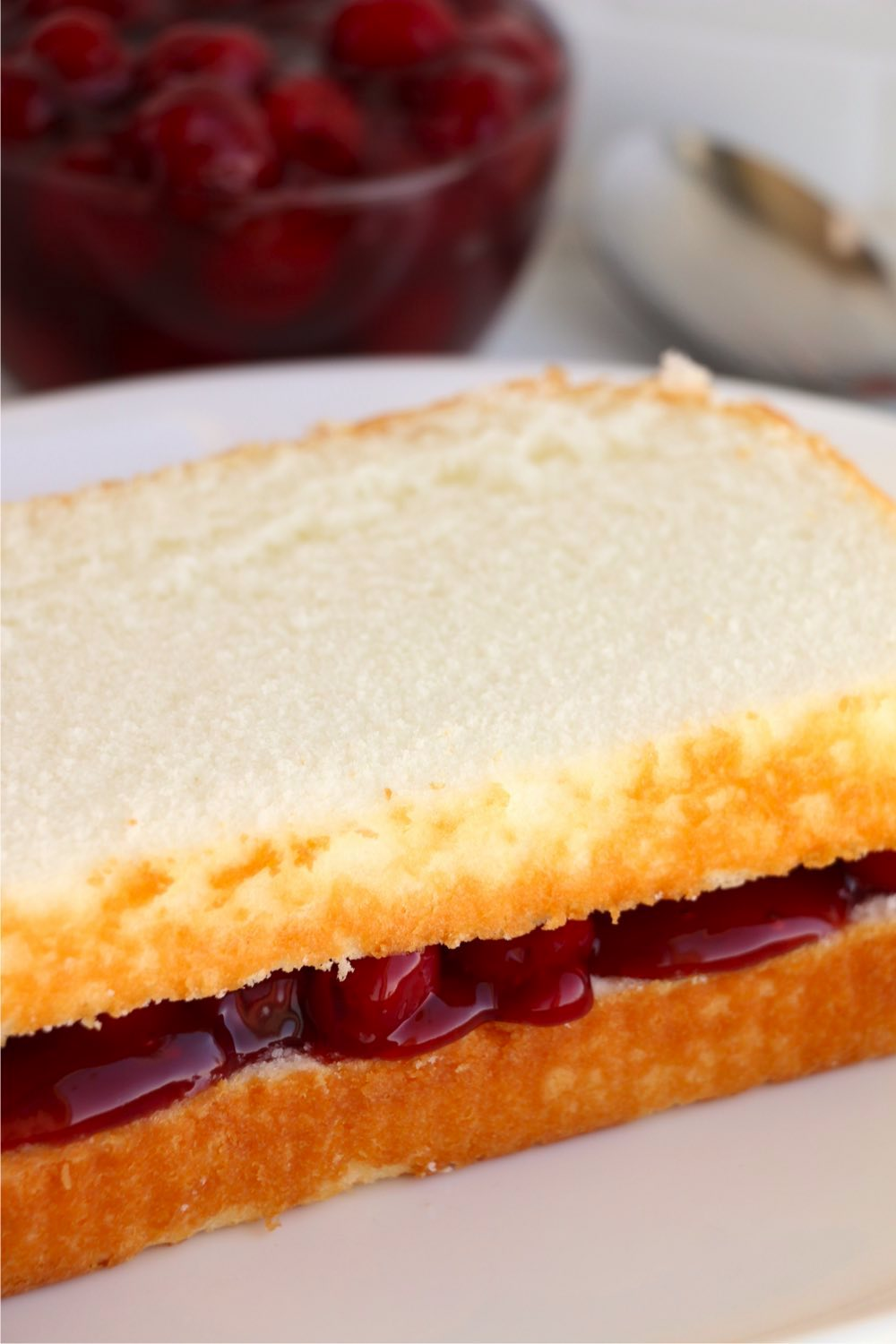 layers of pound cake with canned cherries in the middle