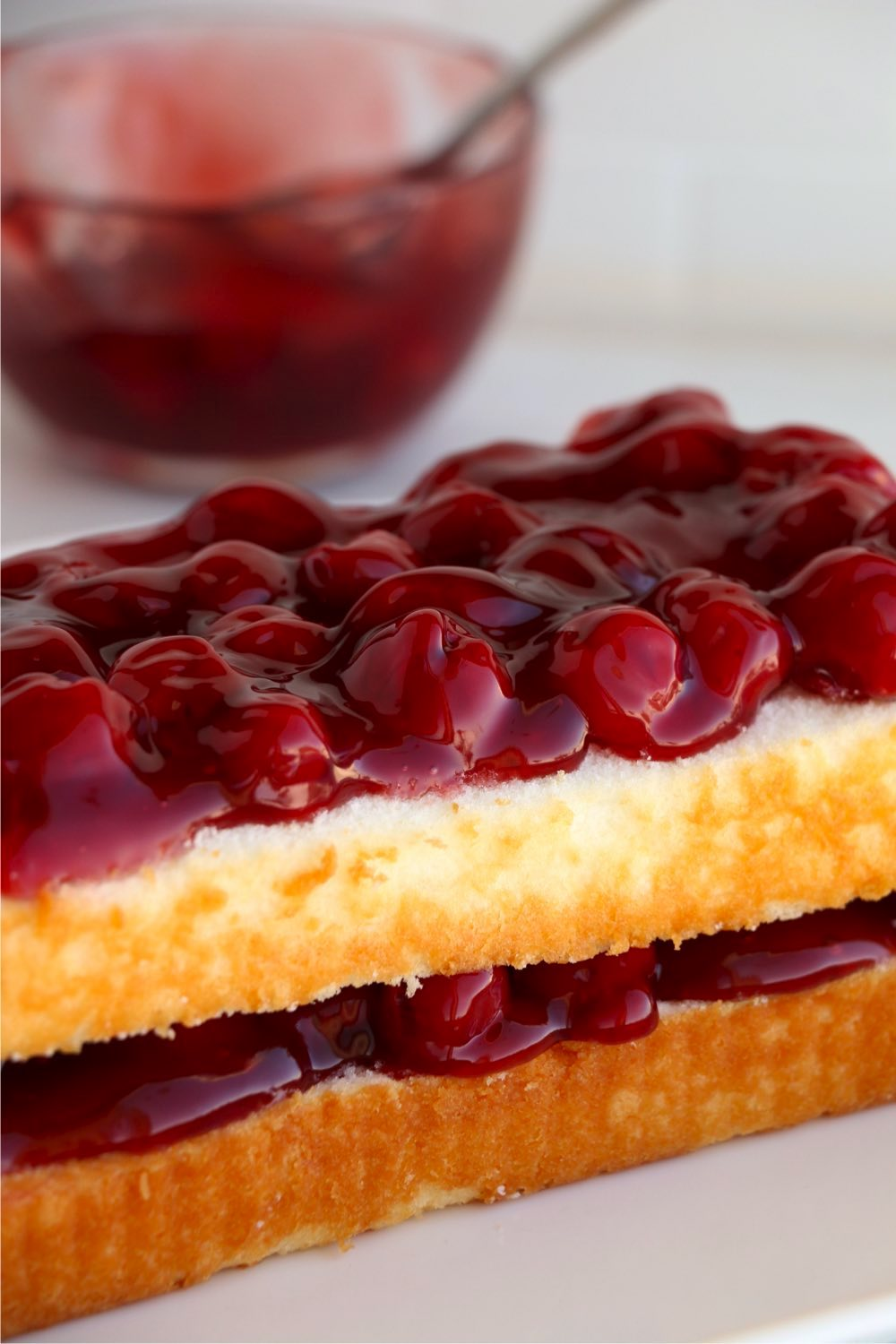 cherry pie filling on top of pound cake layers