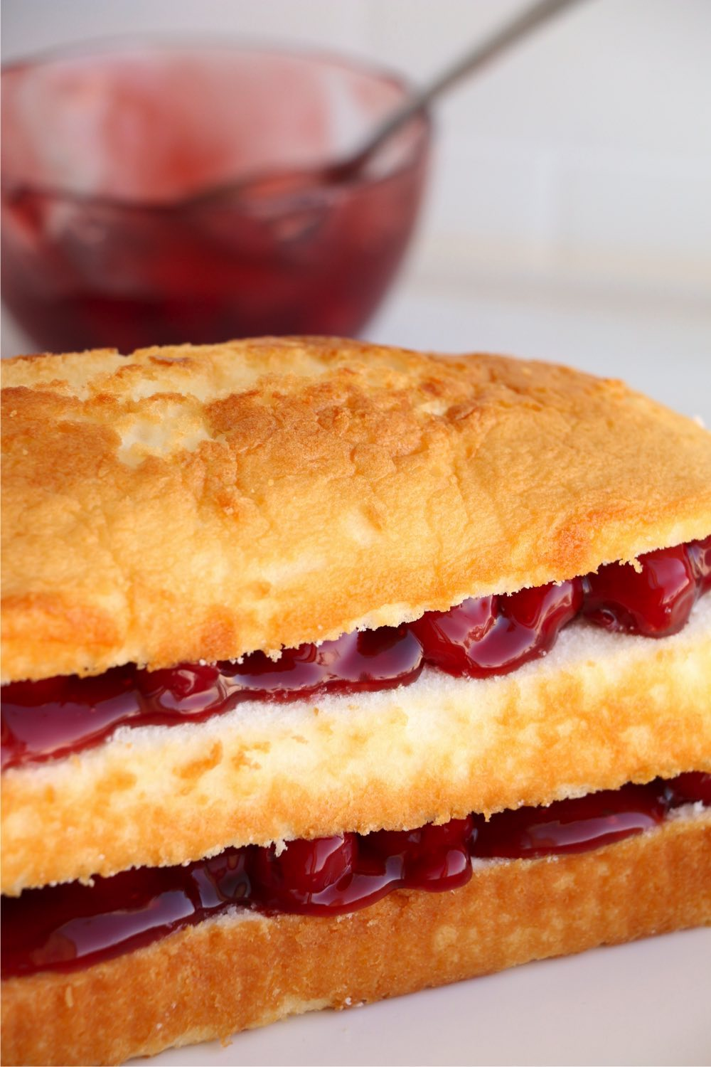 Pound cake with cherry pie filling layers