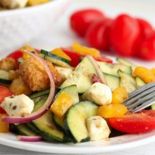 bright colorful salad on a white plate